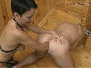 Leather girl double fists his arse then puts foot in | doublefootgirlleather