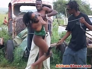 Enchained African babe gets abused by two horny black guys | abuseafricanbabeblackgayhorny